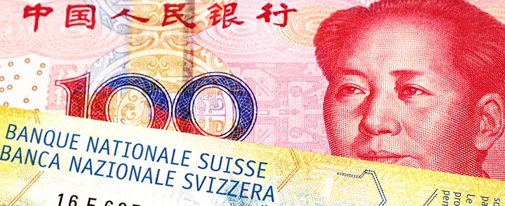 billet chinois de 100 wuans et billet suisse